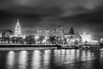 Beautiful cityscape, Moscow at night, the capital of Russia, city lights and reflection in the river, black and white image