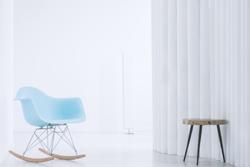 Rocking chair in bright interior