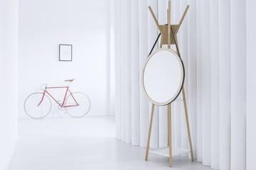 Simple interior with round mirror