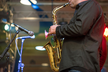 Saxophonist playing a saxophone.