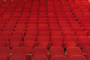 View of an empty theatre with old red seats