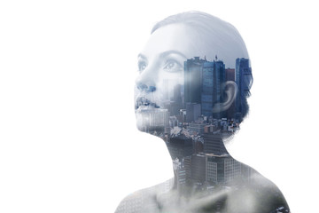 Double exposure of young woman and building exterior.