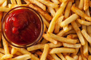 Delicious french fries and ketchup - top view