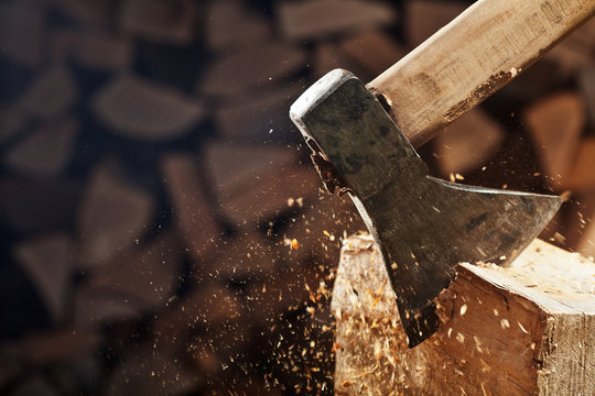 Chopping wood with axe - closeup on flying wooden chips - copy space