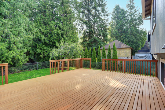 Empty walkout deck with redwood railings