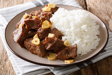 Philippine food: Salpicao beef with garlic and rice closeup on a plate. horizontal