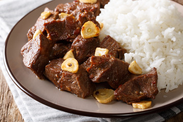 Traditional Filipino beef Salpicao with garlic and rice closeup. horizontal