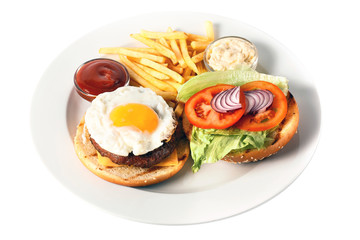 Opened cheese burger with grilled cutlet, cheese, scrambled egg with yolk, tomato, onion, two kind of sauces and salad, as well as roasted potatoes On a round plate. Isolated on white