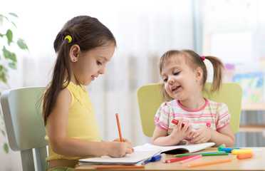 Kids drawing in kindergaten. Children painting in nursery. Preschooler with pen at home. Creative toddlers.