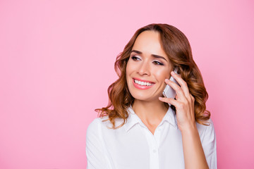 Close up portrait of smiling happy joyful peaceful carefree attractive woman calling to her best friend, isolated on vivid bright pink background
