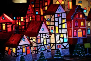 An Image of some paper houses - cardboard