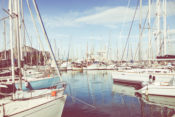 Boats and yachts parked in La Cala bay, old port in Palermo, Sicily, Italy.