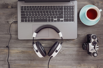 Headphones and laptop on table