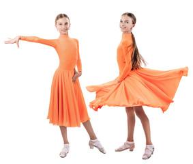 Little dancer girl in beautiful ballroom dress.