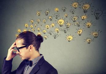 Man wearing nerdy glasses having many ideas thinking organizing thoughts