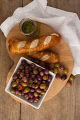 Overhead view of olives with bread