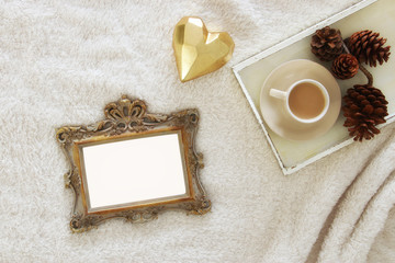 Empty wooden photo frame over cozy and warm fur carpet. For photography montage. Top view.