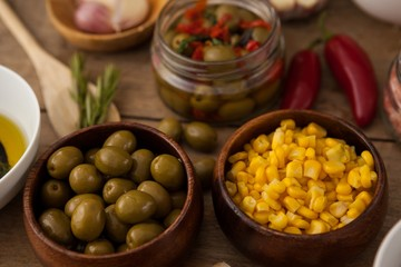High angle view of corns and green olives