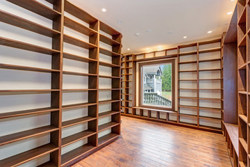 Traditional style library with built-in bookshelves