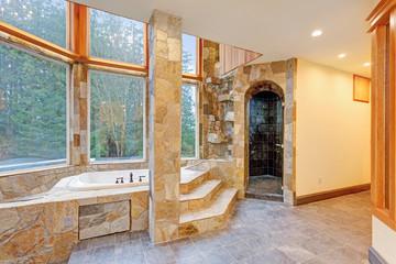 Luxurious Drop-In Bathtub paneled in stone tiles