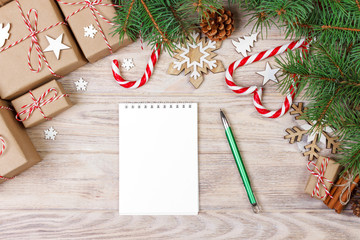 Christmas background with notebook on wood and xmas decoration
