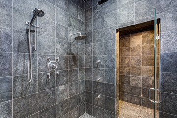 Luxurious mansion walk-in shower with black square tiled walls