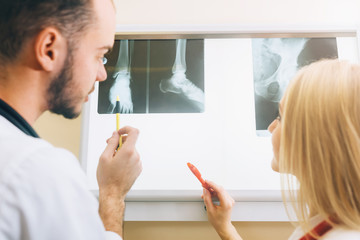 Two young doctors looking at x-ray healthcare, medical and radiology concept