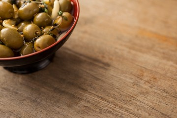 Cropped image of olives with spice in bowl