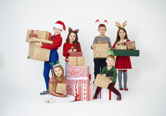 Happy children with a lot of gifts
