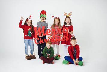 Group of children celebrating christmas together