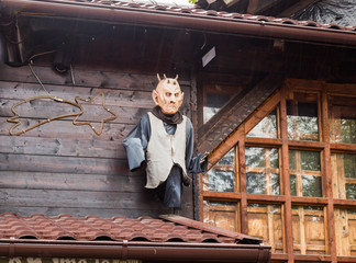 Decorative vampire figure attached to the wall near the entrance to the  Bran castle in Bran city in Romania