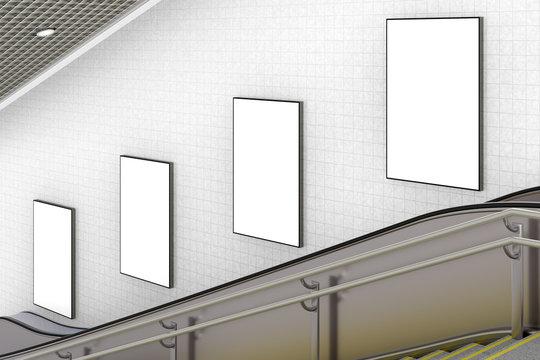 Blank advertising poster on underground escalator wall