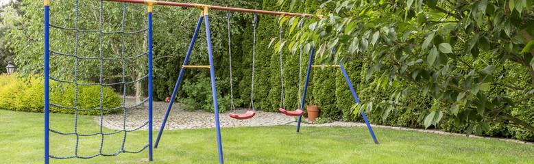 Blue playground in garden