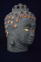Buddha statue burning candle religion home decoration