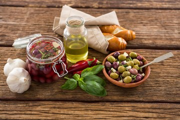 Pickled olives with ingredients and bread
