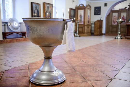 Bath for the sacrament of baptism in the Christian Church. Baptismal Font - a large bowl-shaped receptacle. Church utensils for the sacraments and rites.
