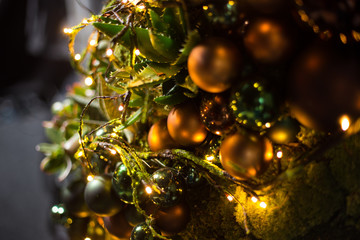Fir branch with balls and festive lights on the Christmas background with sparkles