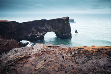 Natural rocky arch. Scenic landscape of Iceland