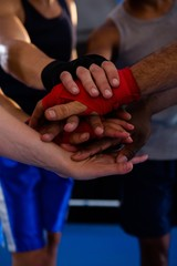 Close-up of boxers stacking hands