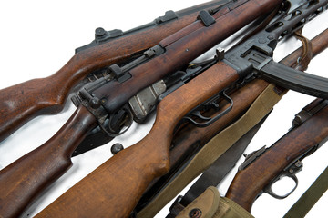 antique firearms weapons, rifles, machine guns isolated on white background