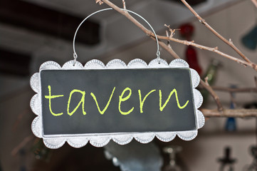 alerts and ads on a small blackboard: tavern