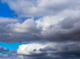 rain clouds on a blue sky as a background
