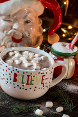 Hot chocolate Christmas mug with holiday scene closeup