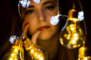 A young woman surrounded by lights