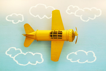 Concept of imagination, creativity, dreaming and childhood. Retro toy plane with info graphics sketch on the blue background.