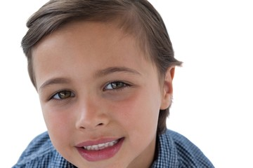 Smiling boy against white background