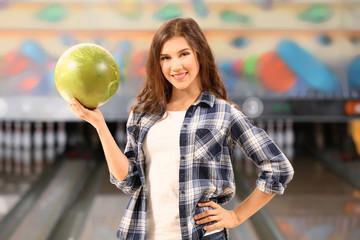 Beautiful young woman at bowling club