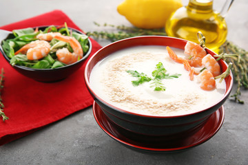 Bowl with yummy shrimp cream soup on table