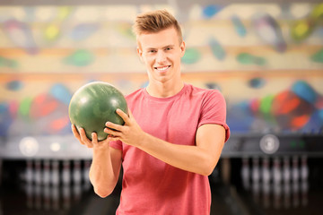 Handsome young man at bowling club