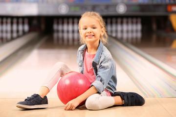 Cute little girl at bowling club